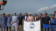 شنای طلاب شیعه و سنی به مناسبت هفته دفاع مقدس در خلیج گرگان